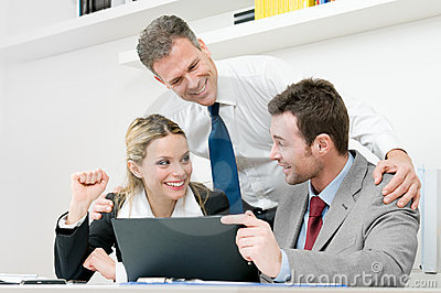 Happy business team celebrate