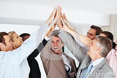 Happy business team celebrating success
