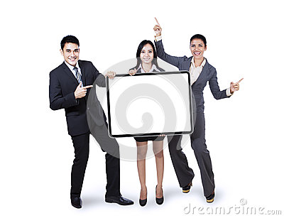 Happy business team holding billboard
