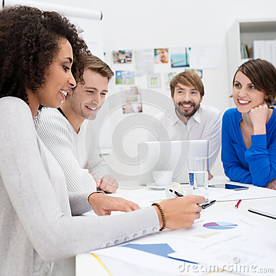 Happy business team sitting in a meeting