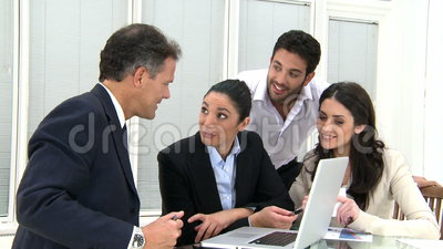 Happy business teamwork at office. Happy business team discussing and working together at office meeting with laptop. Businesspeople at working meeting with the