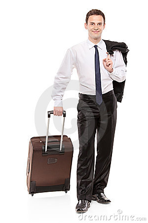 Happy business traveler carrying his luggage