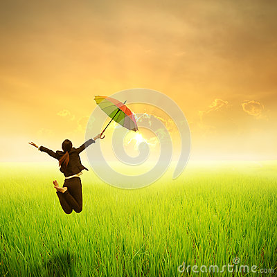 Free Happy Business Umbrella Woman Jumping In Green Rice Field And Sunset Stock Photos - 48561943