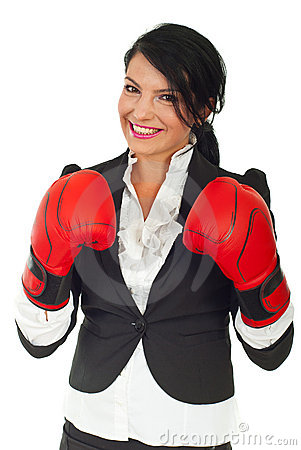 Happy business woman with boxing gloves