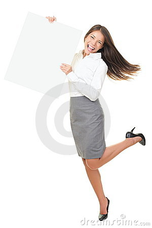 Happy business woman dancing jumping holding sign