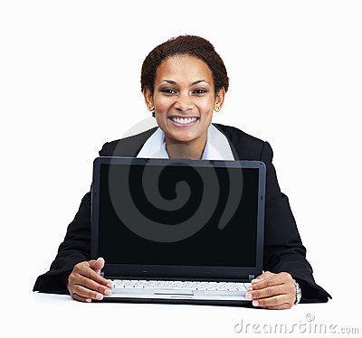 Happy business woman displaying a laptop on white