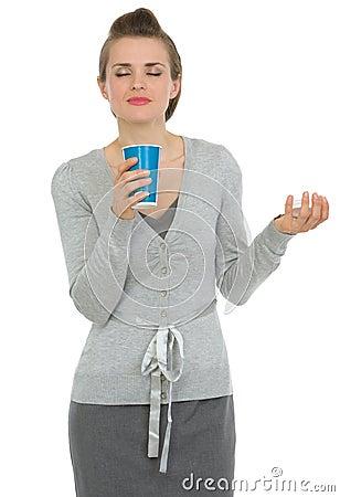 Happy business woman enjoying odor of coffee