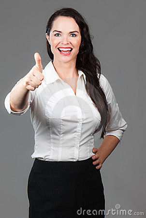 Happy business woman giving thumbs up