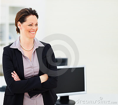Happy business woman with hands folded