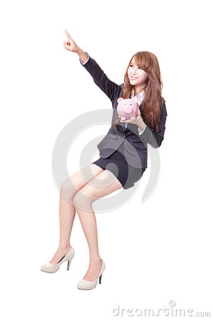 Happy business woman holding pink piggy bank