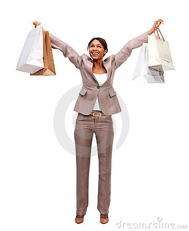 Happy business woman holding shopping bags
