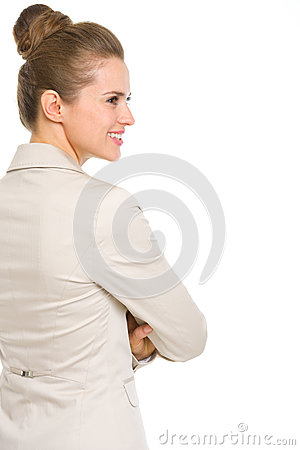 Happy business woman looking on copy space