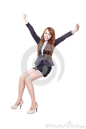 Happy business woman sitting