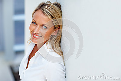 Happy business woman smiling confidently