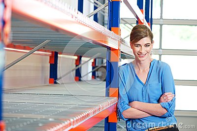 Happy business woman in warehouse