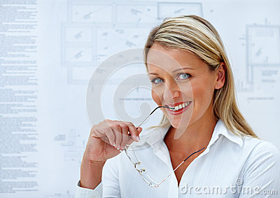 Happy business woman in white holding spectacles