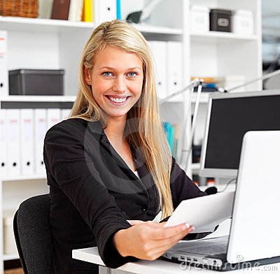Happy business woman working in office