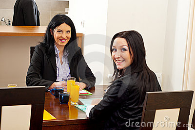 Happy business women at meeting table