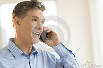 Happy Businessman Answering Smart Phone