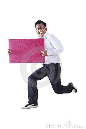 Happy businessman with a blank sign