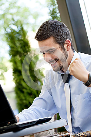 Happy businessman browsing  on internet