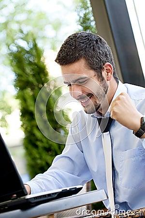 Happy businessman browsing  on internet