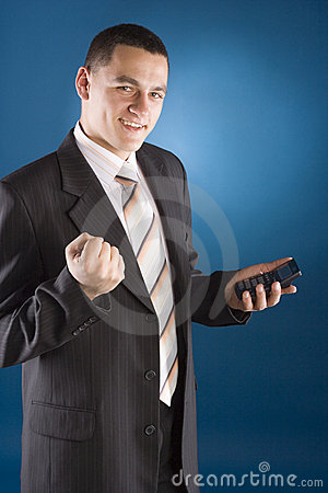 Happy businessman with calculator in his hand