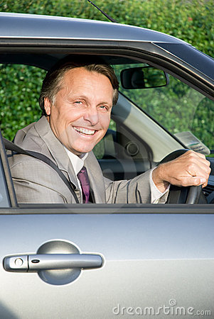 Happy businessman in car