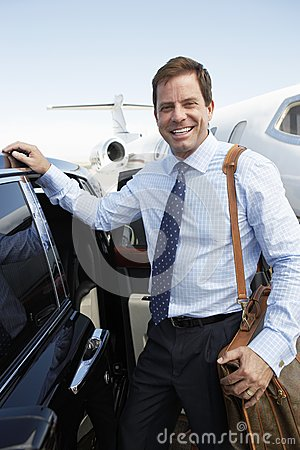 Happy Businessman By Car At Airfield