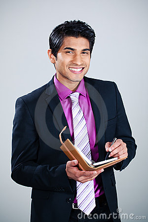 Happy businessman with diary