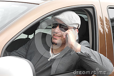 Happy businessman driver talking