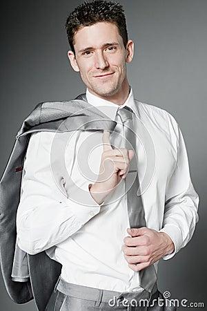 Happy businessman in elegant gray suit.