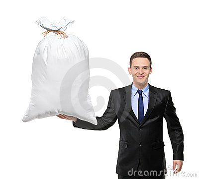 A happy businessman holding a bag with money