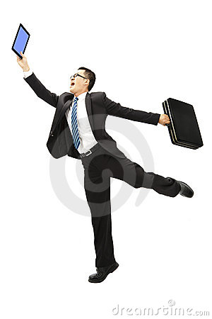 Happy businessman holding tablet pc