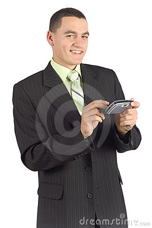 Happy businessman with palmtop / mobile
