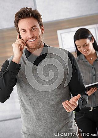 Happy businessman on phone Stock Photo