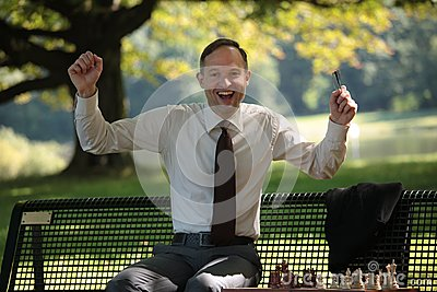 Happy businessman playing chess