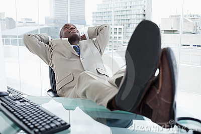 Happy businessman relaxing
