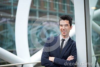 Happy businessman smiling outdoors