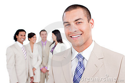 Happy businessman standing in front of his team