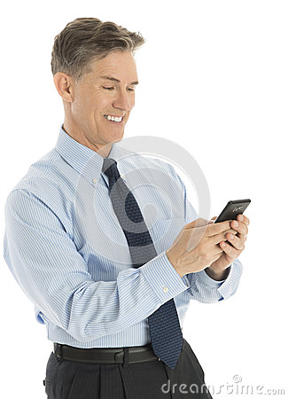Happy Businessman Text Messaging Through Smart Phone