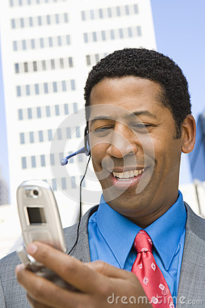 Happy Businessman Using Cell Phone