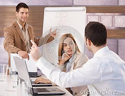 Happy businesspeople having training