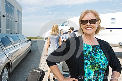 Happy Businesswoman Against Private Jet