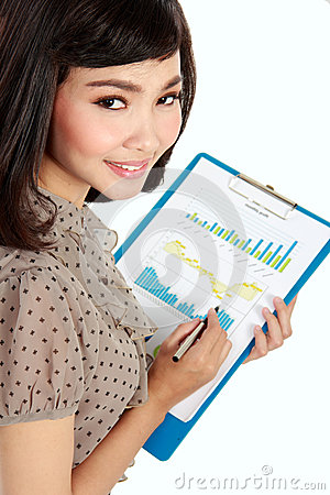 Happy businesswoman with annual report