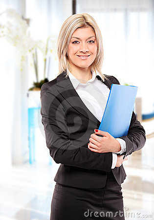 A happy businesswoman with blue folder