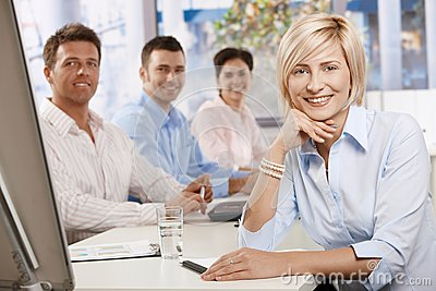 Happy businesswoman in boardroom