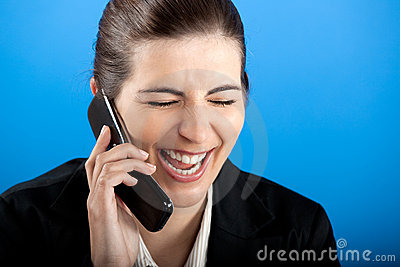 Happy businesswoman calling at phone