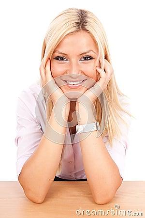 Happy businesswoman at her desk