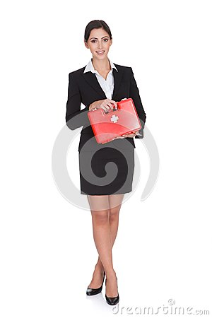 Free Happy Businesswoman Holding First Aid Box Stock Image - 29081861